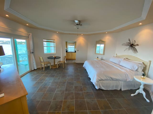 Suite with full kitchen, table and two chairs as well as a California King and large closet.