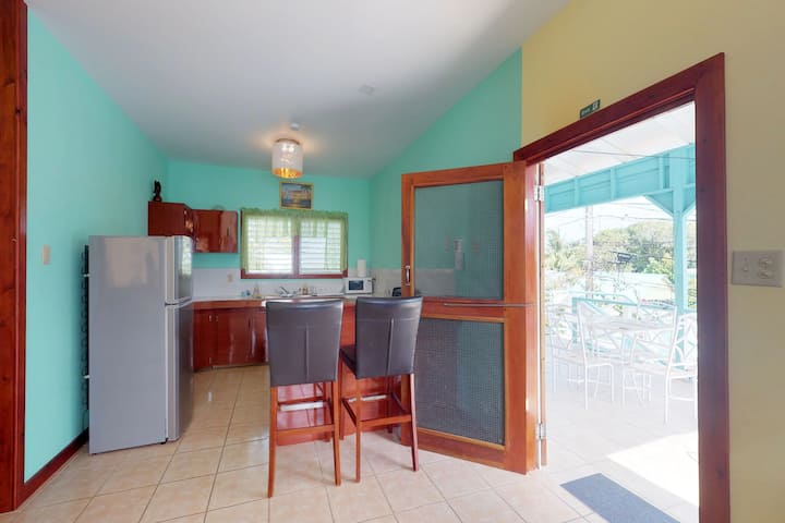 Breezy, in-town villa w/ shaded deck, partial AC & WiFi - steps to the beach!