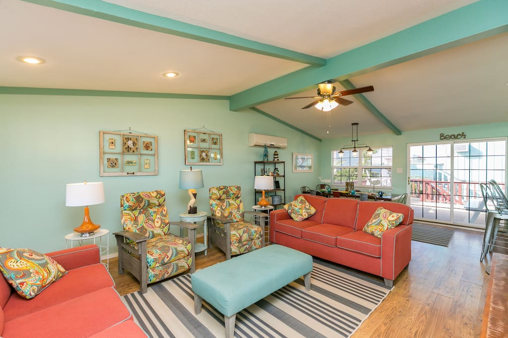 The living room is bright, open, and airy with plenty of space for the whole group.