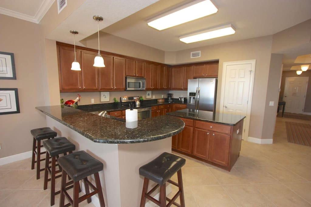 Full kitchen with stove, dishwasher, microwave, and all small appliances.