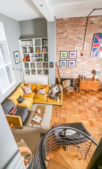Wonderful vintage furniture and feature brick wall