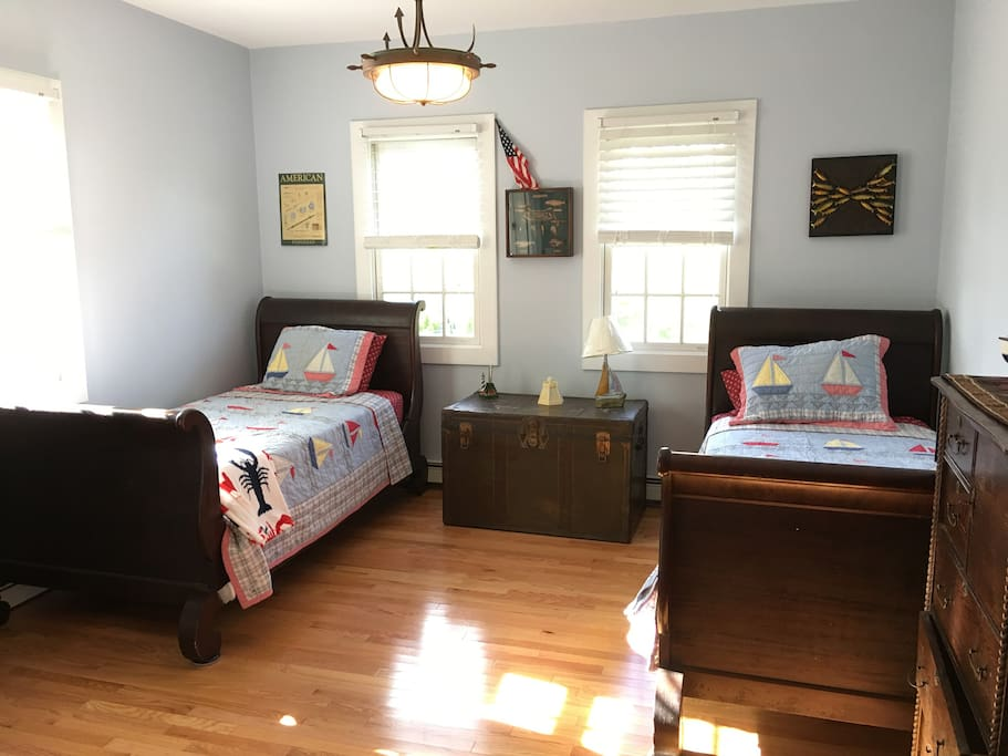 Nautical 2nd floor room with 2 single beds and a half bath