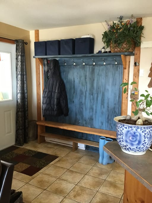 Entrance with bench and coat hooks.
