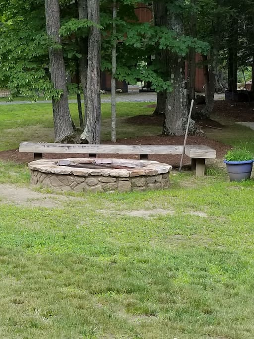 Fire Pit with firewood for your use.