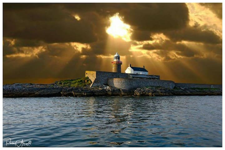 Fenit Lighthouse on Little Samphire Island at Sunset. Tralee Bay.