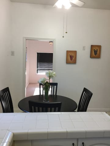 Standing in the kitchen by the stove looking past the breakfast table into the home office,
