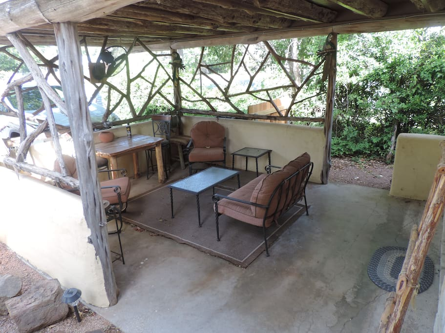 Outdoor covered veranda - perfect for coffee in the morning or a glass of wine in the evening!