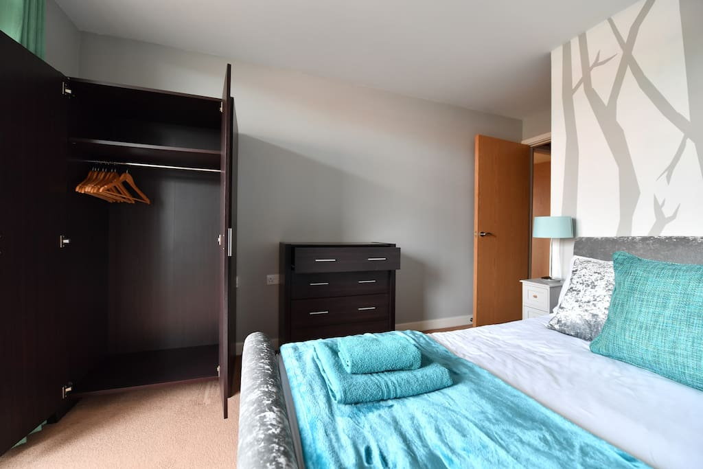 Bedroom has double French doors to large balcony.