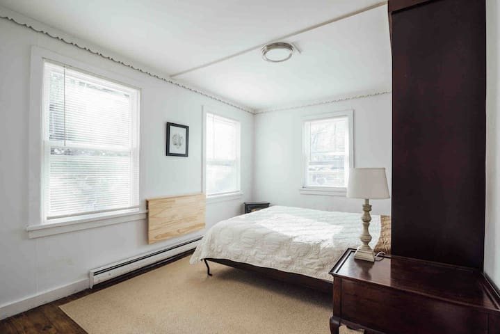 Rear bedroom with Queen sized Murphy Bed.   For home office, lift bed and raise  wall-mounted desk.