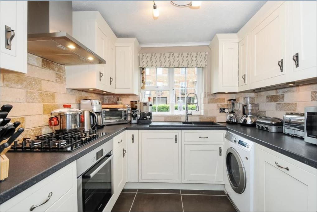 The fully fitted kitchen features all Bosch integrated appliances, dishwasher, washing machine & upright Samsung fridge freezer.