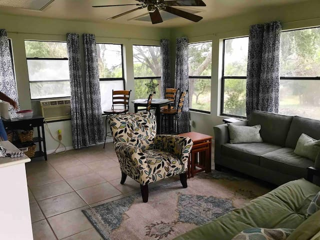 Living room with futon, cable tv, WIFI, coffee maker, microwave, and fridge