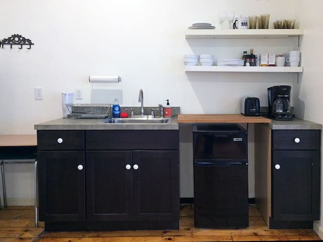 Kitchenette with coffee maker, mini-fridge, microwave, toaster oven, etc.