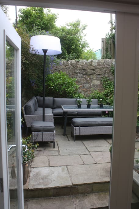 Enjoy dining alfresco in the garden with heater and BBQ