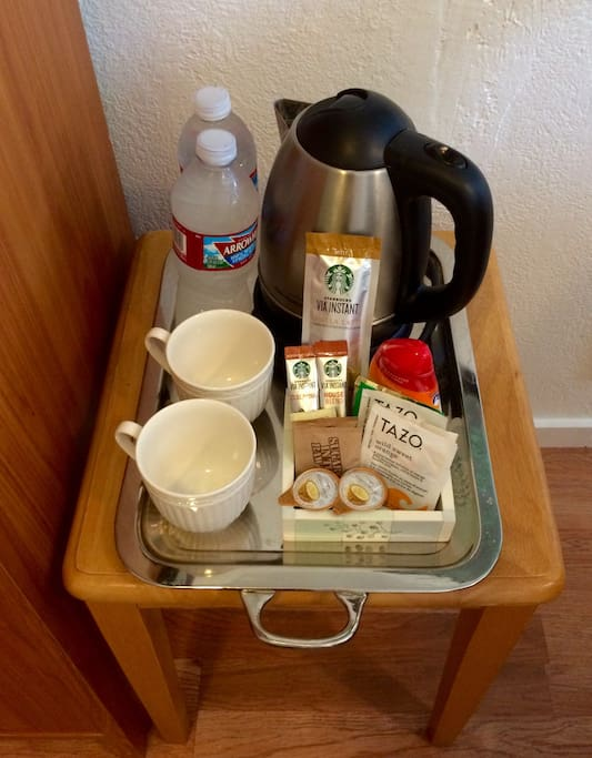 Cold bottled water, kettle, coffee, tea and all the fixings if you want to enjoy a cup without leaving your room (there is also s Keurig coffee machine & tea available in the kitchen).  ☕️