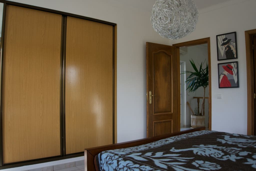private bedroom with large built-in cupboard