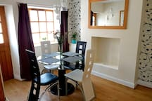 Dining room with table and seating for 4. Perfect for eating in or for take aways.