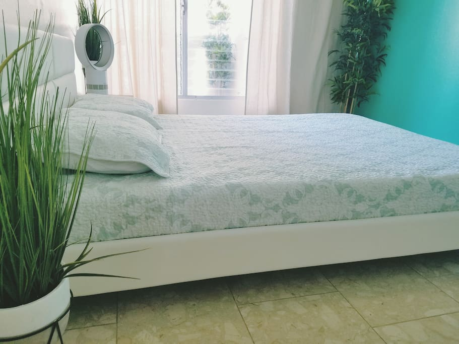 Queen sized bed with memory foam mattress and pillows