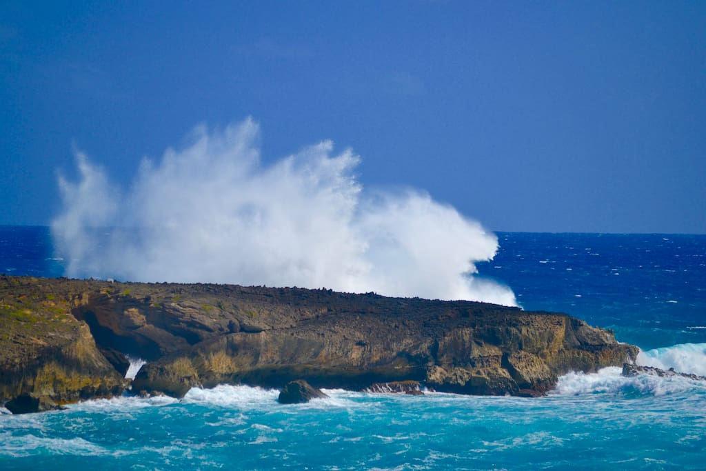 You can see, hear, and feel the power of the ocean from the safety and comfort of the house. This photo of waves crashing onto iconic Kukuiko'olua Island was taken from the lanai of our home. Take a short walk to the end of the point to see the famous sea arch in the middle of the island.