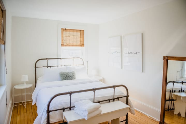 The third queen bedroom is the largest on the second floor, includes a full length mirror, and plenty of drawer and closet space. Two windows let the sunlight in and allow for a nice cross breeze.