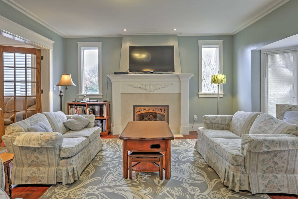 The elegant formal living room includes a lovely fireplace to keep you warm during the colder months.