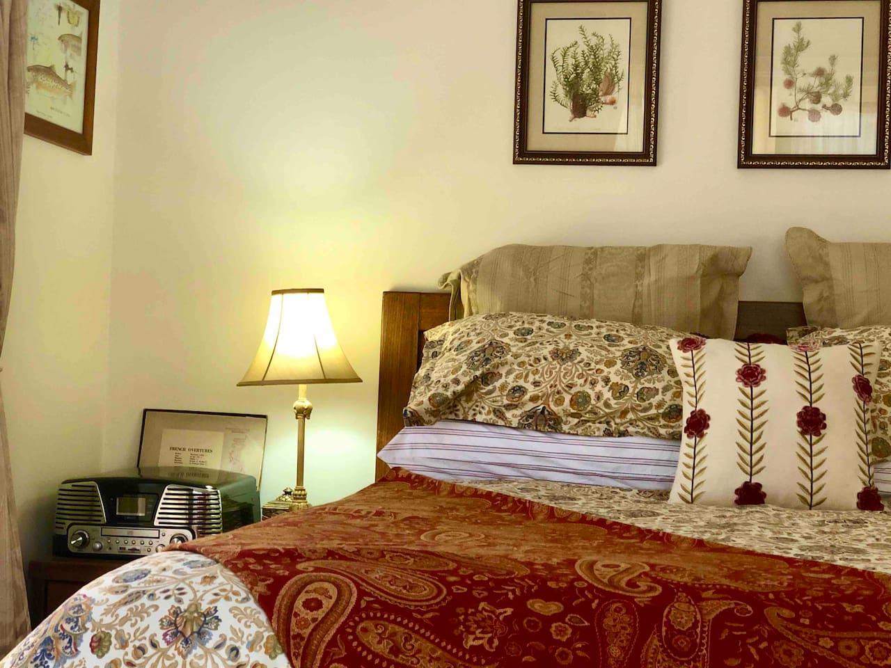 "Luxurious Queen size bed, Ralph Lauren ""Marrakesh"" fine linens.  Record player with LPs Celia Rosser ""The Banksias"""