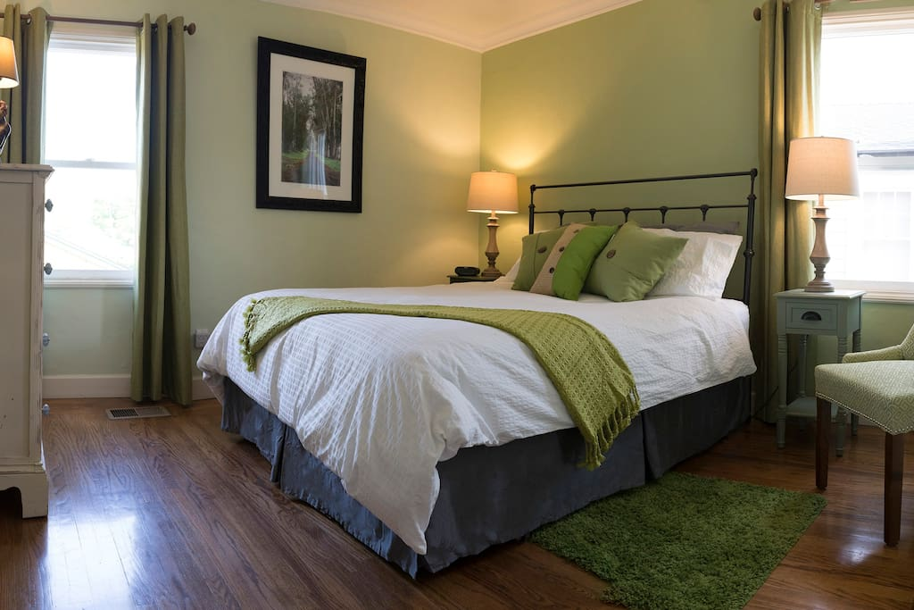 Green Bedroom. Overhead fans, windows, closet, dresser, hardwood floors.