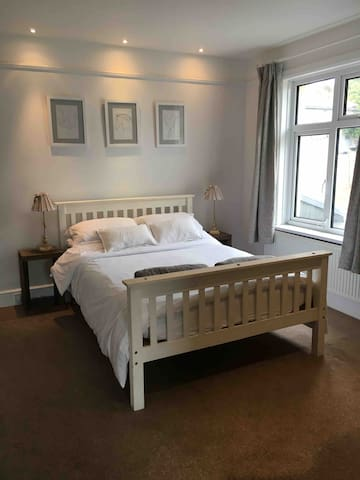 Bedroom 1 with double room and en-suite shower room