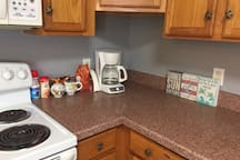 Fully equipped kitchen with all utensils, pots and pans, coffee and condiments.