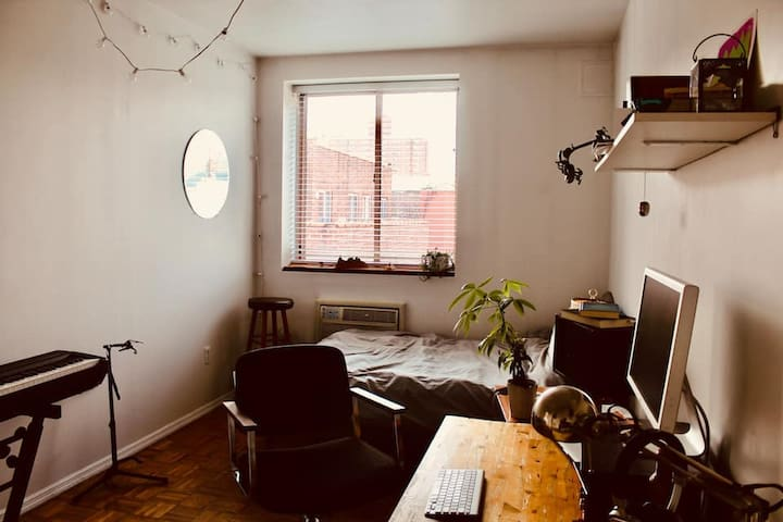 the master bedroom of the penthouse!   Over 150 square feet in an East Village apartment is practically unheard of, especially when it also doubles as a music studio.