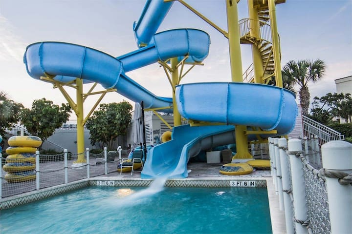 Relaxing Lazy River, Beach Access, Water Slide and Much More!