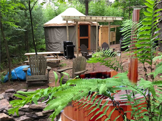 Our wonderful 16' yurt was pitched for the first time in Fall 2017 after arriving from Pacific Yurts in Oregon. In the foreground, our new off-grid, cedar wood-fired hot tub!