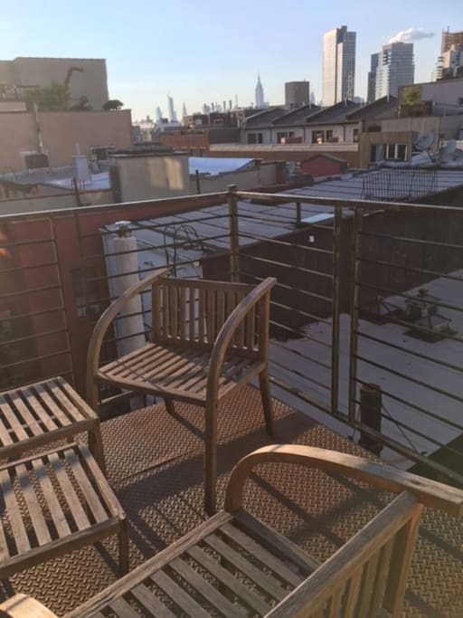 Apartment private balcony with a grill, garden, and gorgeous views of Manhattan