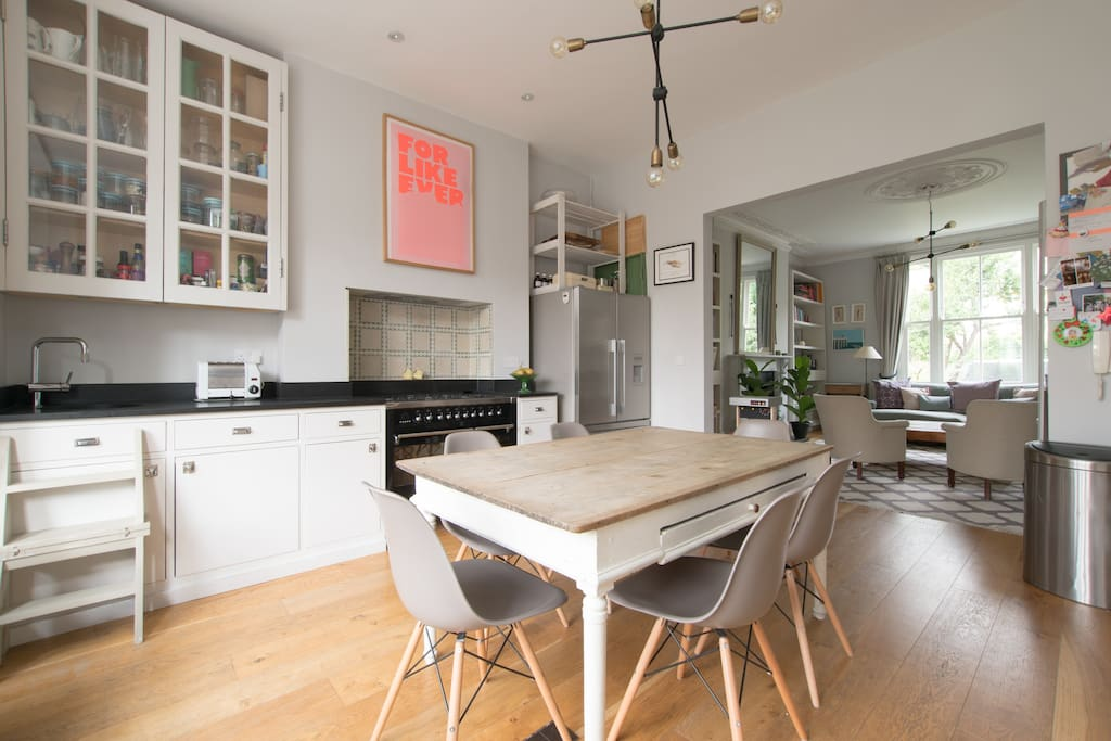 The open-plan design of the ground floor shows off the kitchen and sitting room.