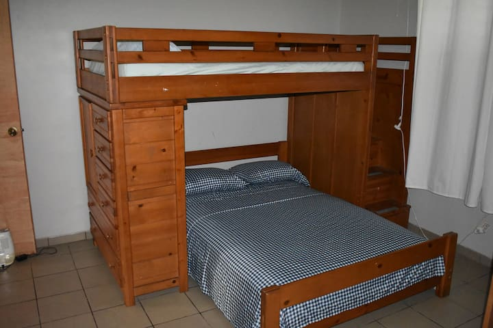 Full bed and upper twin bed.