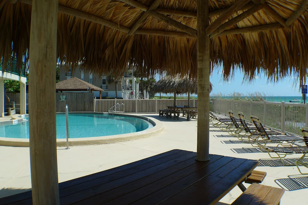 Our tiki huts and pool facing the beach