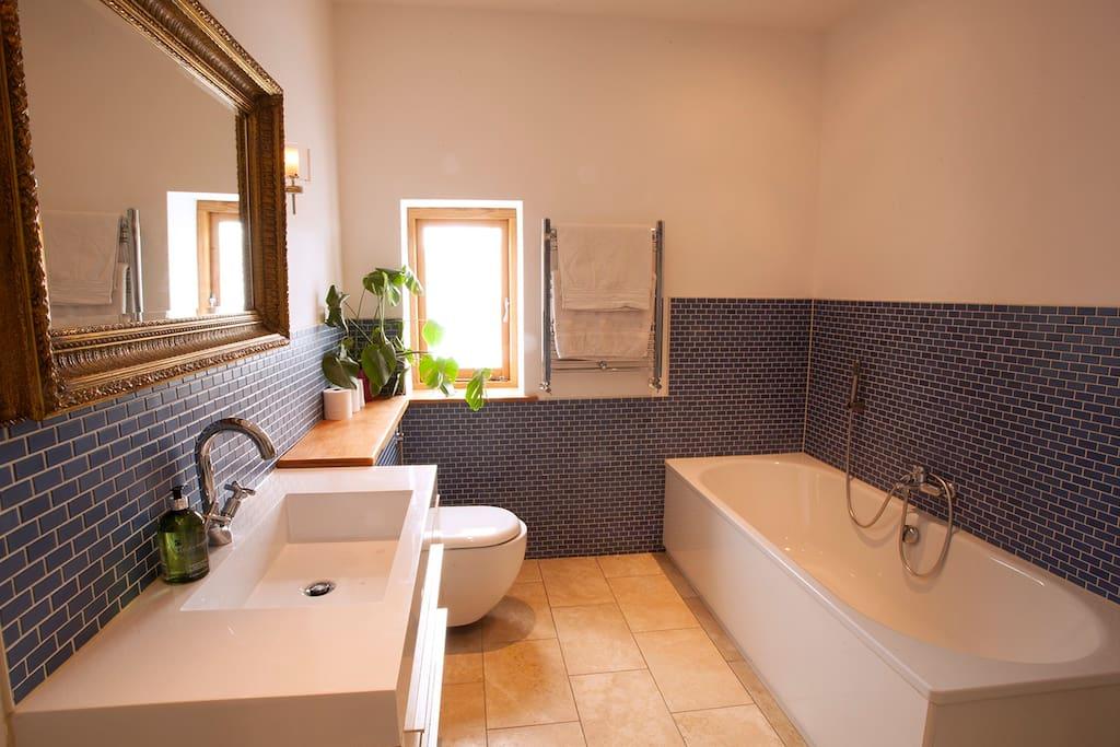 Bath with handheld shower