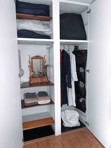 Wardrobe for you clothes.  Stocked with bathrobes, slippers, towels, laundry-bag, umbrella and eco friendly shopping-bag.