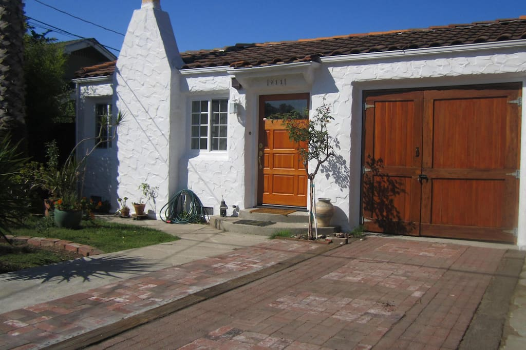Front of House; entry gate to left; parking in driveway