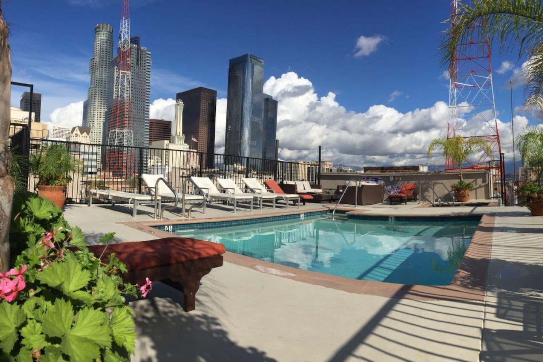 Rooftop pool overlooking beautiful skyline view.