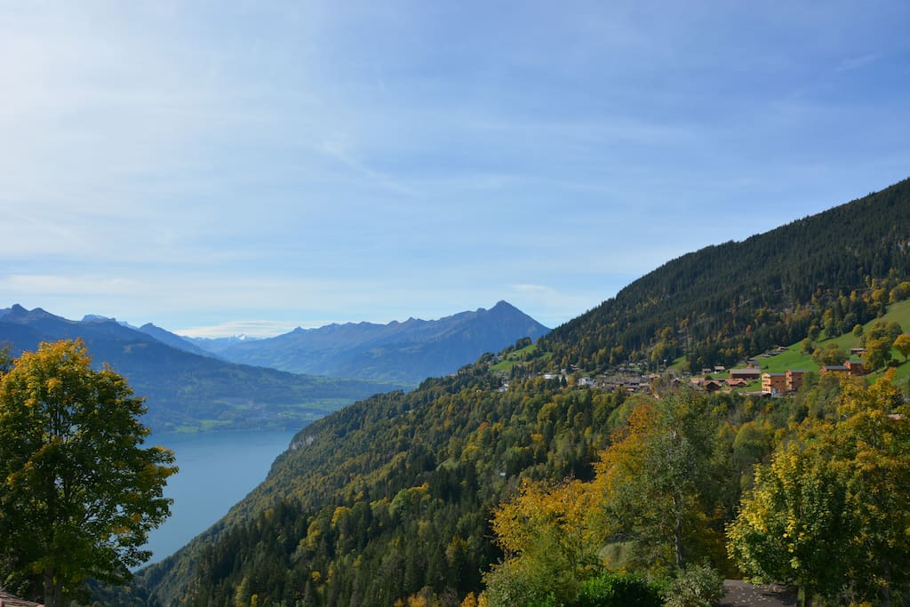 View out of bedroom window of Lake Thun and Niesen in Fall