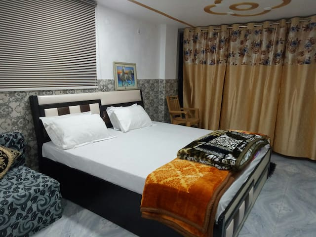 Furnished room with attached bathroom and balconey