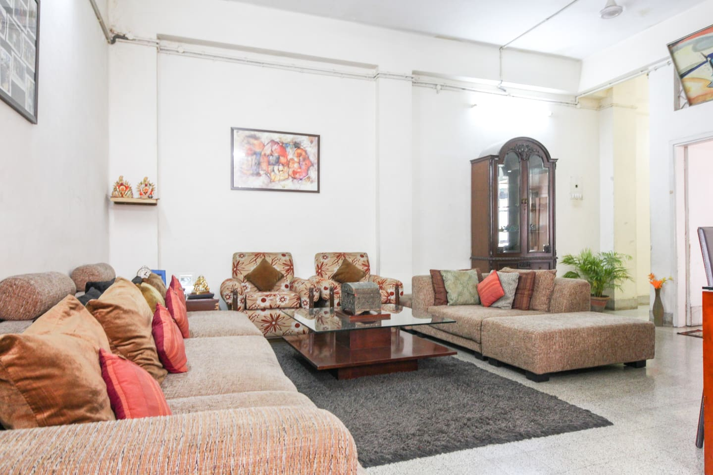 This is a big living room with good seating areas with comfortable couches to sit or to rest also . There is a dining space which can used for eating meals as well as working on the laptop . There is free wifi with good speed . There is a 42 inch TV