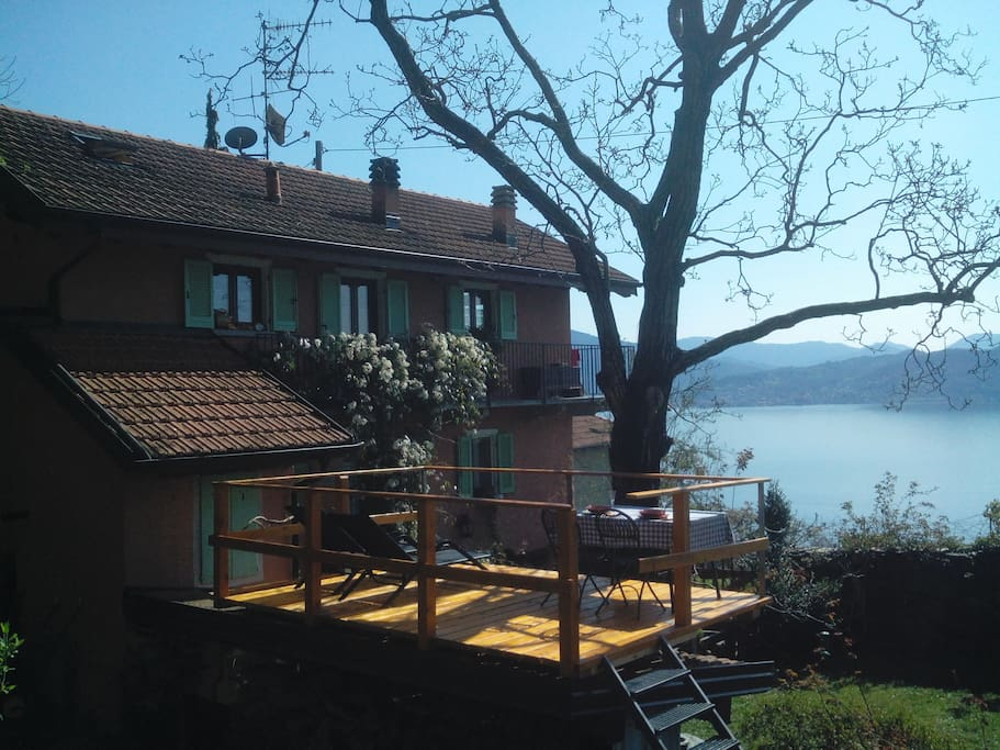 the new terrace , the lake  and the house