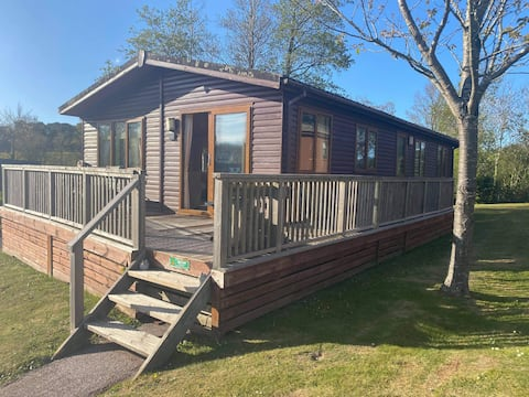 Beautiful Log cabin  within a well presented park Dean resort Swimming pool, bar, crazy golf, games rooms all on site
