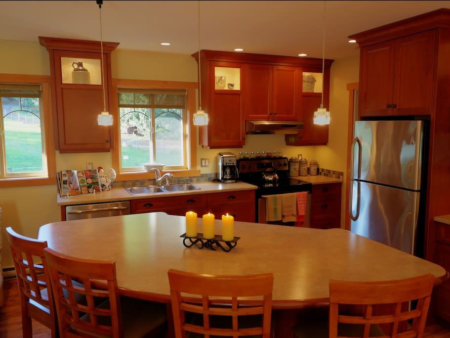 Full kitchen with stainless steel appliances including dishwasher