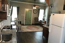 Open floor plan for kitchen, dining, and living room areas