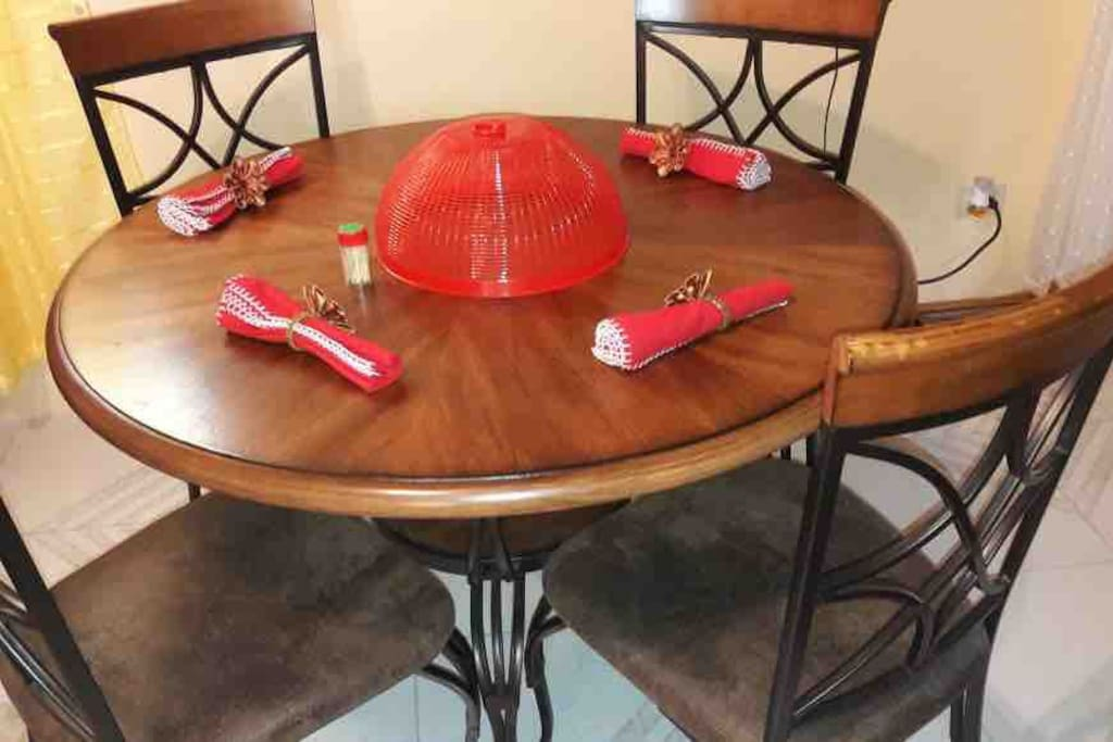 Beautiful wooden Dining table settiny for 4 adults.