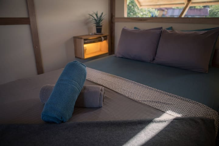 Cabinas Over The Water. Double size bed, shared bathroom and shower with amazing view on the bay.