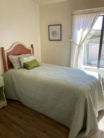 3rd bedroom has an area that could be set up as a work space or host can add a twin sized inflatable bed to accommodate a 6th person.