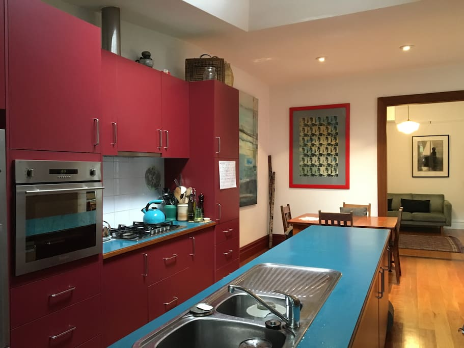 Open plan kitchen with dinning table and seating for 6-8 people. Dishwasher, oven, fridge, microwave and washing machine